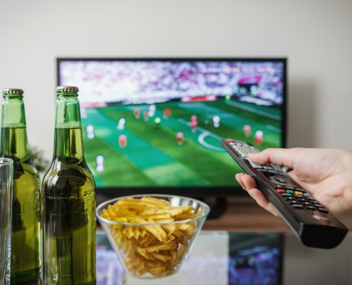 Beer, crisps, tv and football with friends.