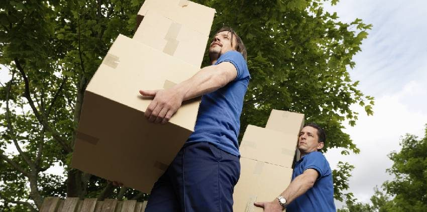 men lifting boxes